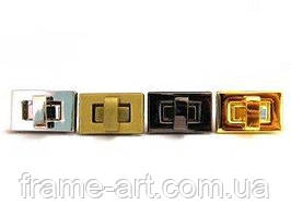 2040 Замок-повортка 818-011 27*17мм золото