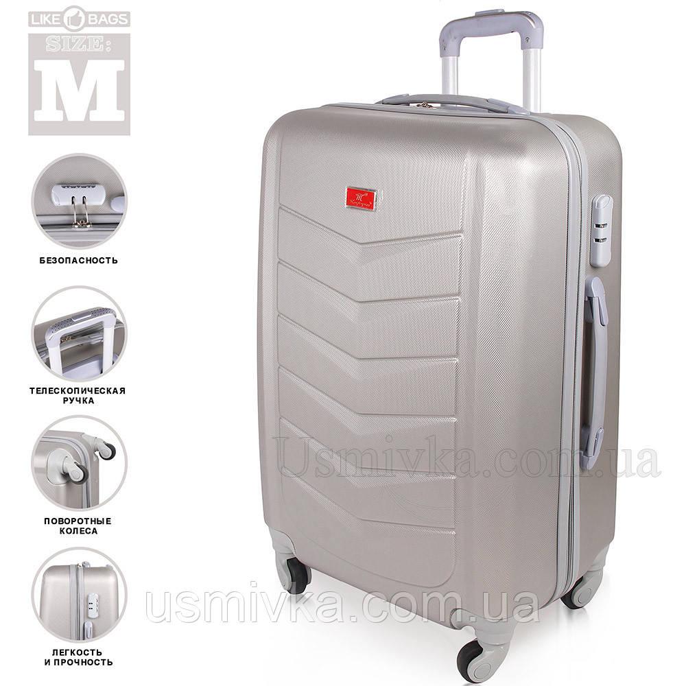 Качественный пластиковый чемодан на колесиках