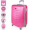 Модный пластиковый чемодан на колесиках