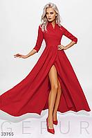 Длинное яркое вечернее платье на запа́х красного цвета