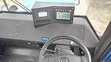 Монитор контроля рабочих показателей трактора или комбайна
