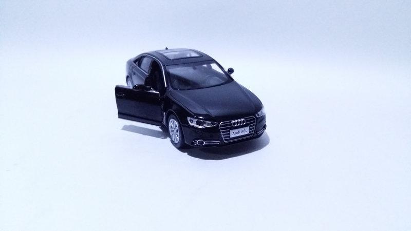 Коллекционная машинка Audi A6 масштаб 1:32 7