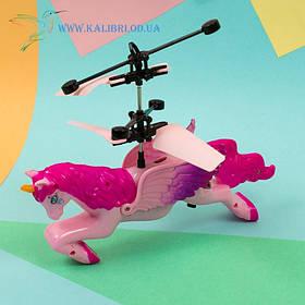 Літаючий, що світиться рожевий єдиноріг