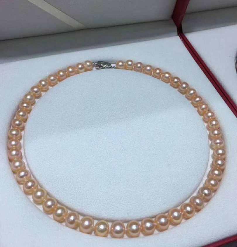 Ожерелье из розового пресноводного жемчуга, с замком из серебра 925 пробы.