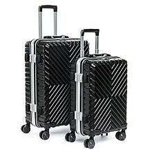 Набор черных чемоданов на колесах для путешествий
