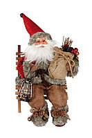 Новогодняя игрушка Санта Клаус на скамье 27 см