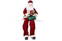 Новогодняя игрушка Сидячий Санта 80см, цвет - красный, BonaDi NY14-492