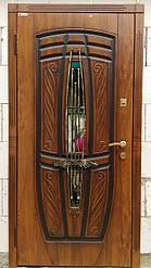 Дверь входная со стеклом и ковкой Пегас серии Комфорт ТМ Каскад