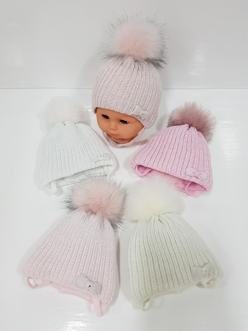 Детские утепленные вязаные шапки оптом с завязками и помпоном для девочек, р.36-38, Grans (Польша)