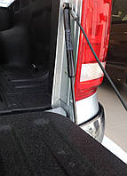 Амортизатор крышки багажника Nissan Navara 2005+