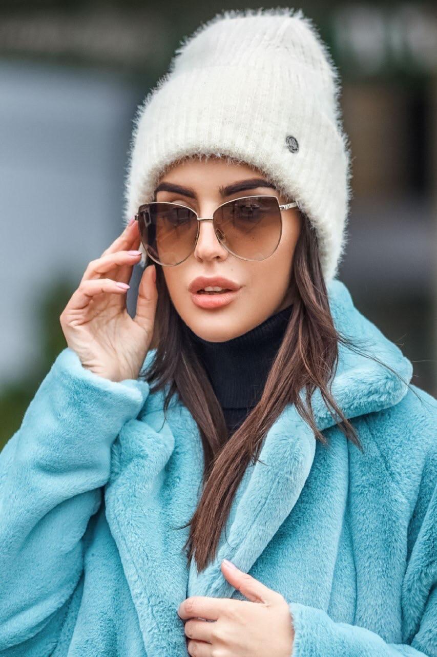 Молодежная вязаная шапка-петушок с отворотом разных цветов