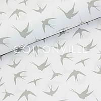 Хлопковая ткань Ласточки серые на белом