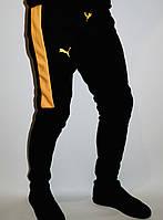 """Штаны спортивные теплые черно желтые на флисе """"Пума"""" на манжете с лампасом."""