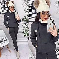 Женский теплый костюм с мехом в капюшоне