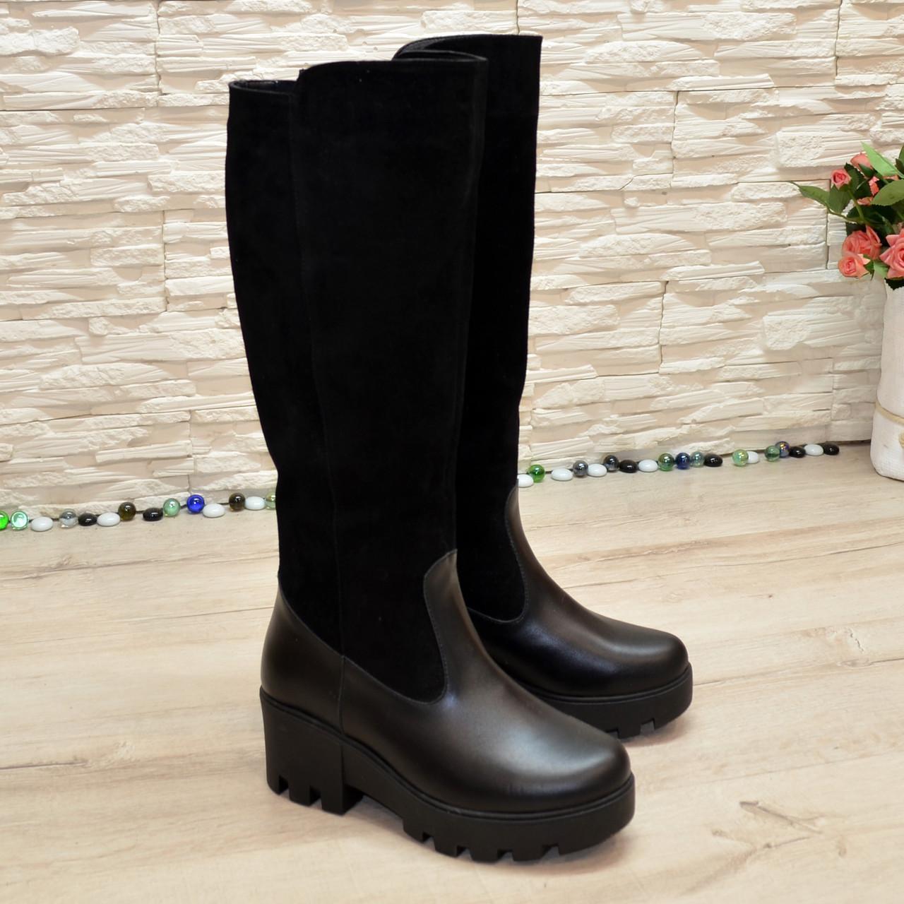 Жіночі об'єднані чорні чоботи на товстій тракторній підошві