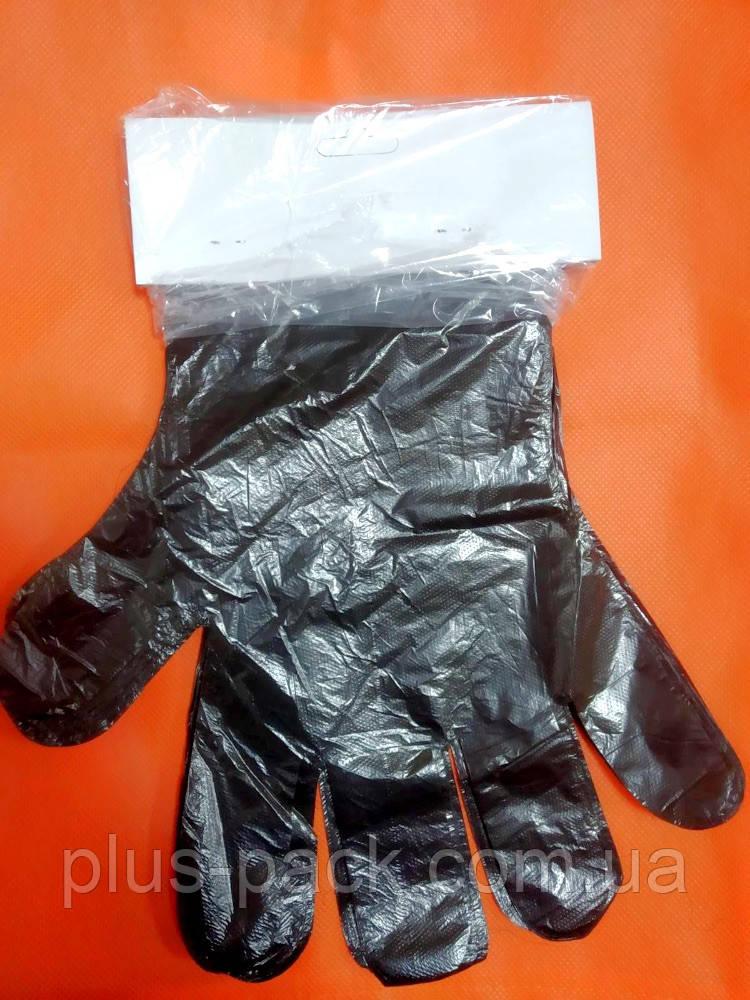 Полиэтиленовые перчатки в чёрном цвете, одноразовые, на планшете
