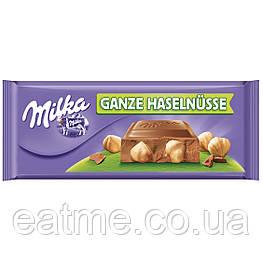 Milka Ganze Haselnüsse Молочный шоколад с цельным фундуком