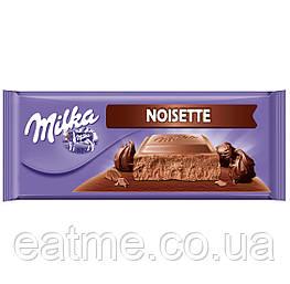 Milka Noisette Молочный шоколад с шоколадным кремом