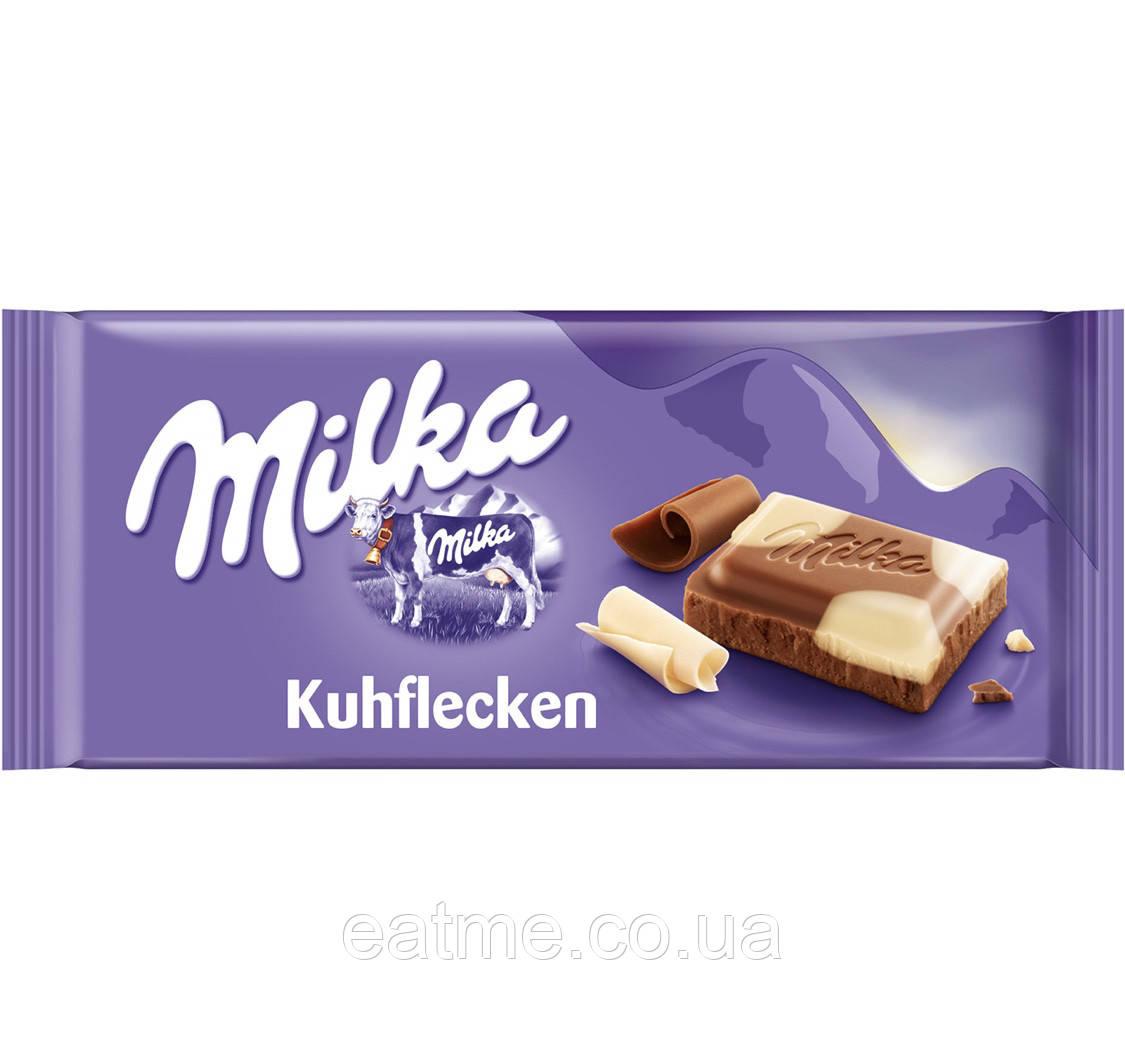Milka Kuhflecken Молочный и белый шоколад