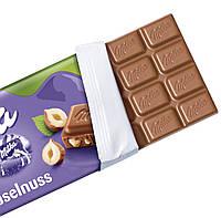 Milka Haselnuss Молочный шоколад с дроблённым фундуком, фото 2