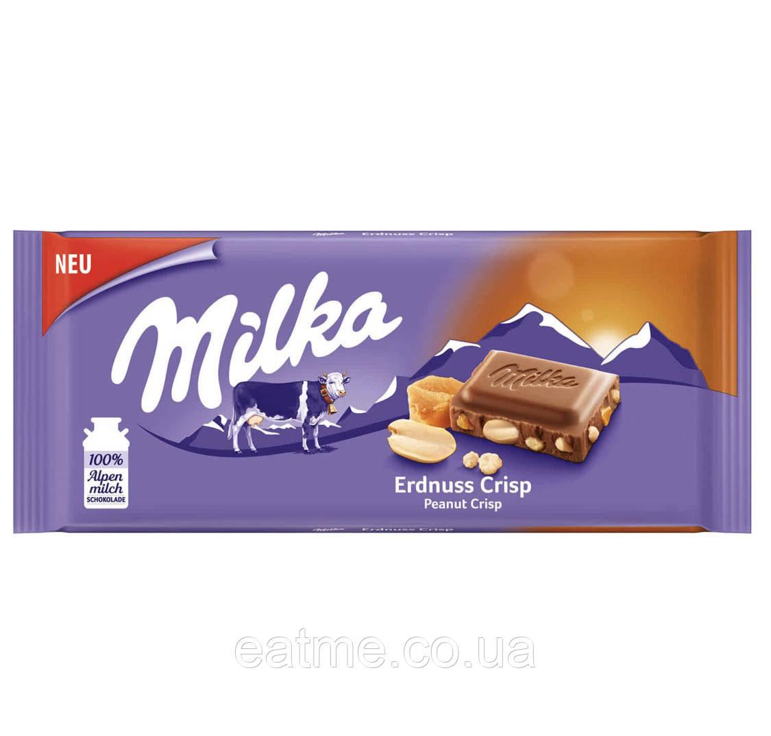 Milka Erdnuss Crisp Молочный шоколад с арахисом и соленой карамелью