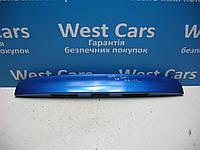 Накладка крышки багажника (панель подсветки номера) Nissan Note 2006-2012 Б/У