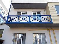 Ограждение для балкона из дерева.