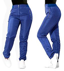 Зимові штани плащівка, теплі штани жіночі на флісі сині