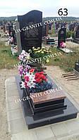 Памятник из черного гранита на кладбище