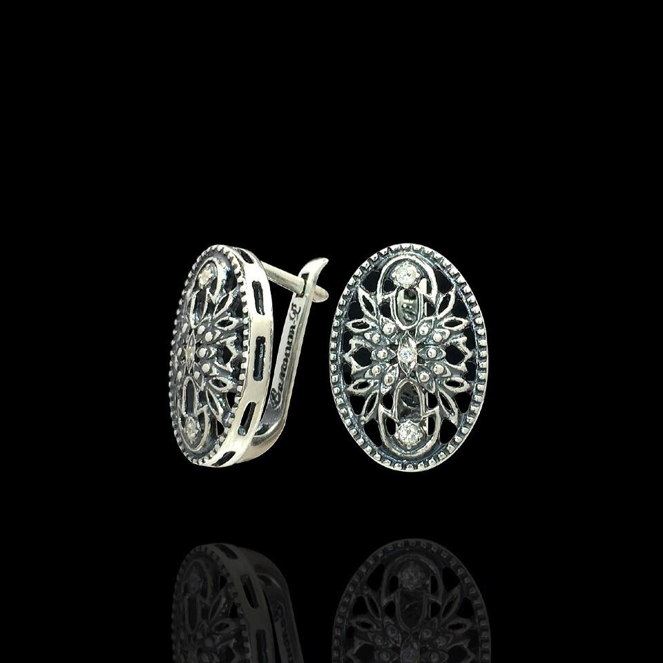 Серебряные овальные серьги с резным рисунком