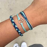 Контрастные серебряные браслеты: как носить многослойные украшения?