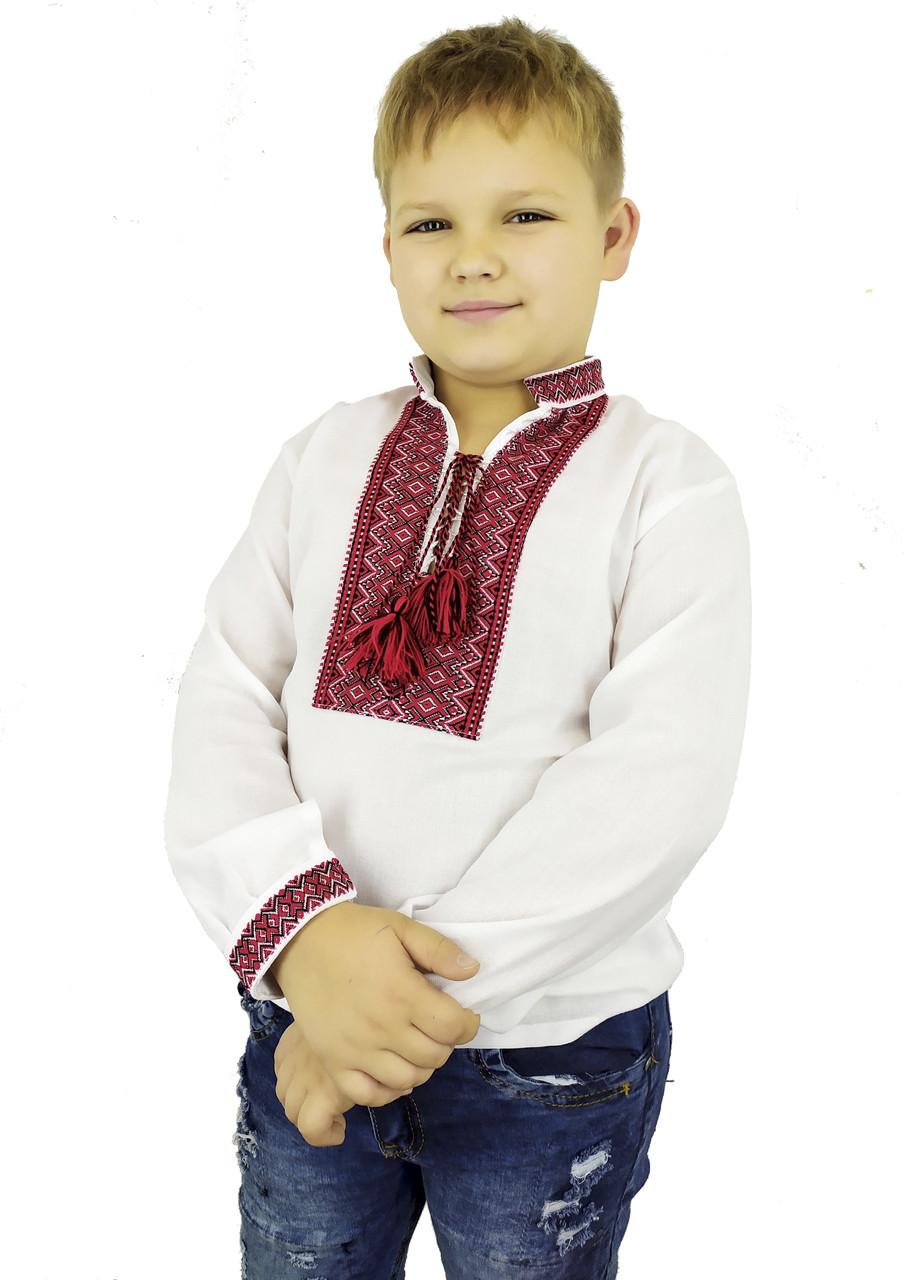 Классическая детская вышиванка в белом цвете с тканой нашивкой
