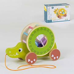 Развивающая игрушка Каталка-Сортер (С 35651) деревянная