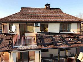 Монтаж систем кріплень на дах будинку.