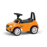 Гр Каталка-толокар 2-006 - цвет оранжевый (1) открывается капот, сиденье, светятся фары, муз.руль, в коробке