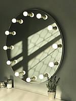 Круглое навесное безрамное зеркало. Диаметр 80 см.