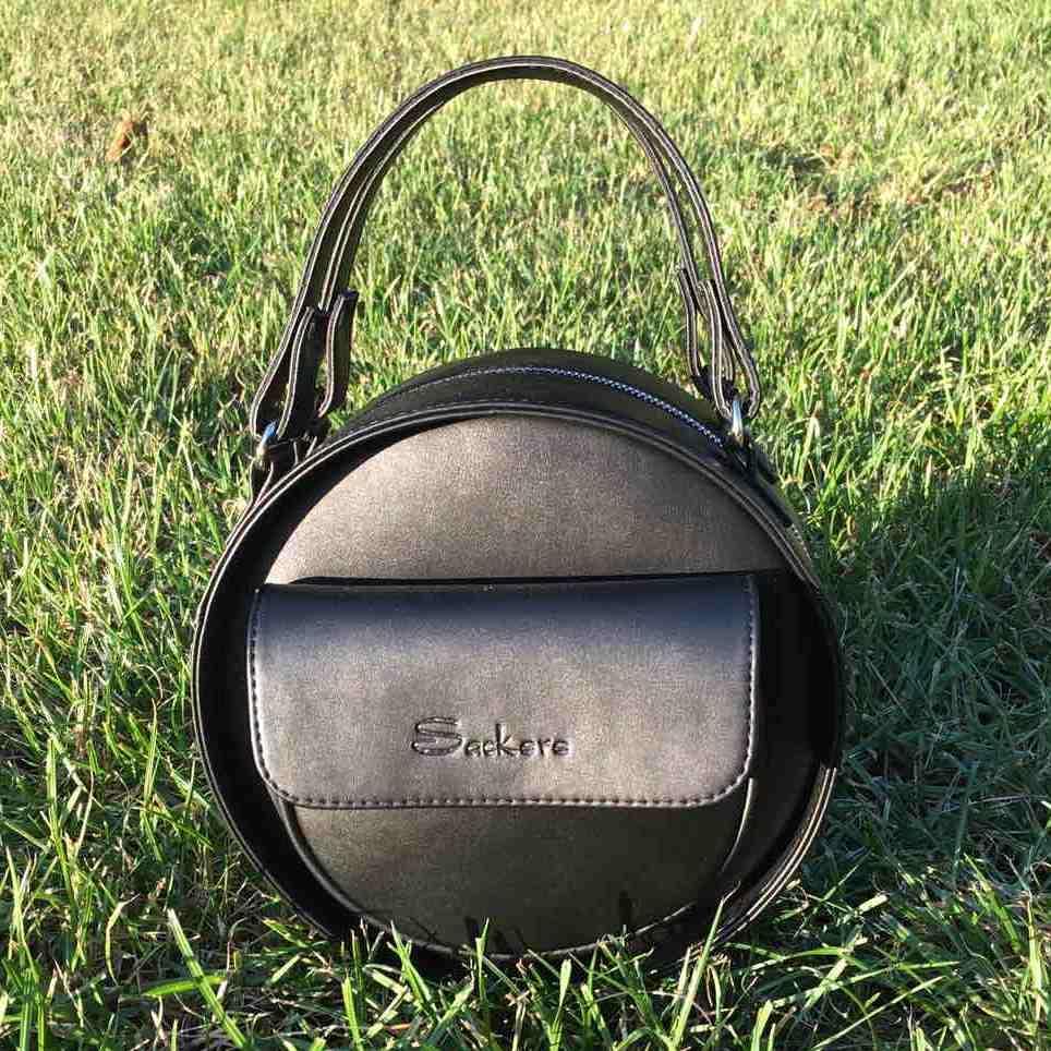 Женская, стильная, круглая черная сумка