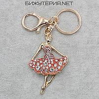Брелок JB Танцовщица металл золотого цвета с красными и белыми стразами - 1066653460