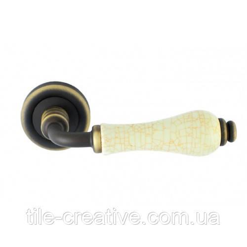 Dalia ручка дверная бронза матовая-потресканный фарфор