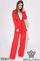 Женский брючный деловой костюм красный