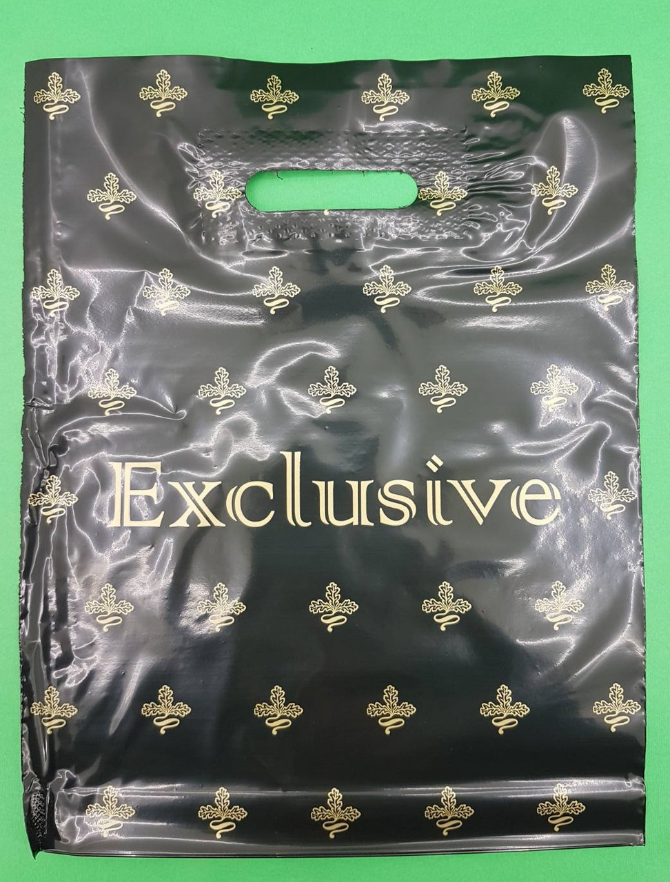 """Пакет полиэтиленовый подарочный маленький с вырубной ручкой (30*40) """"Exclusive"""" (50 шт)"""