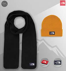 Мужской комплект шапка + шарф The North Face черного и оранжевого цвета (люкс копия)