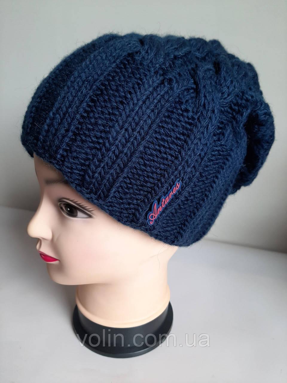 """Женская зимняя вязаная синяя шапка """"Косы""""."""