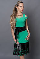 Праздничное платье в модном бирюзовом цвете с перфорированными кожаными вставками