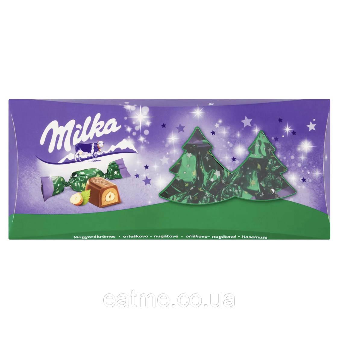 Конфеты Milka c ореховой начинкой и цельным фундуком