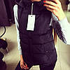 Женская удлиненная синтепоновая жилетка с капюшоном