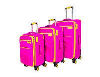 Розовый комплект тканевых дорожных чемоданов на 4х колесах three birds