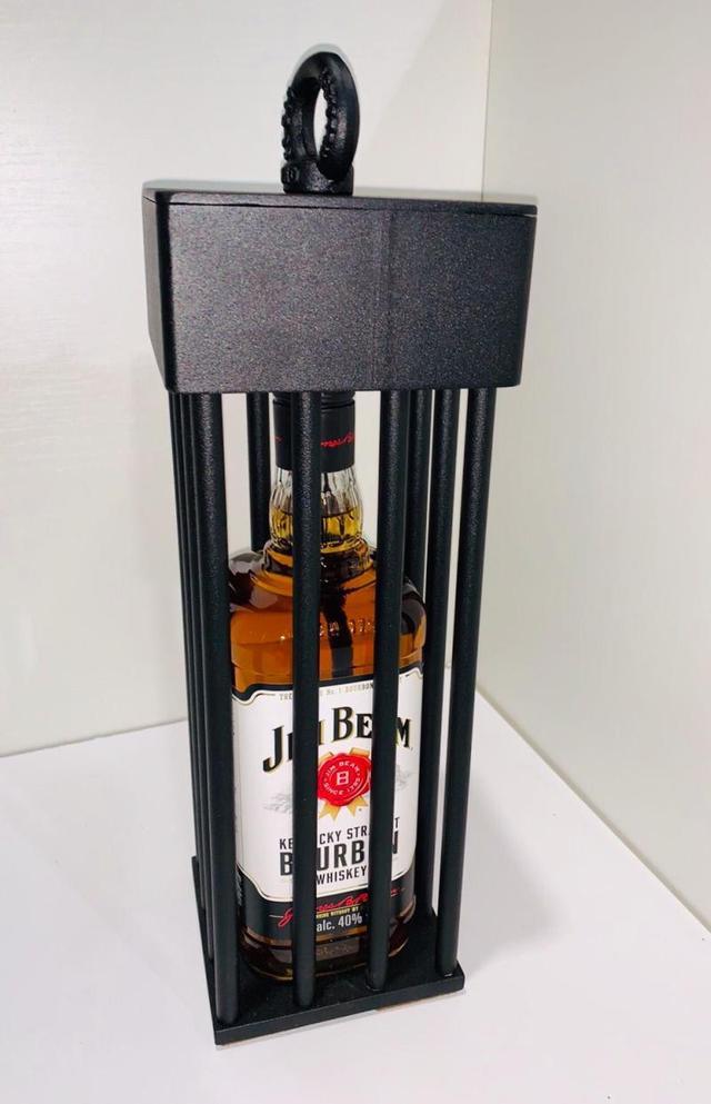 Бутылка в клетке с гайками металлическая