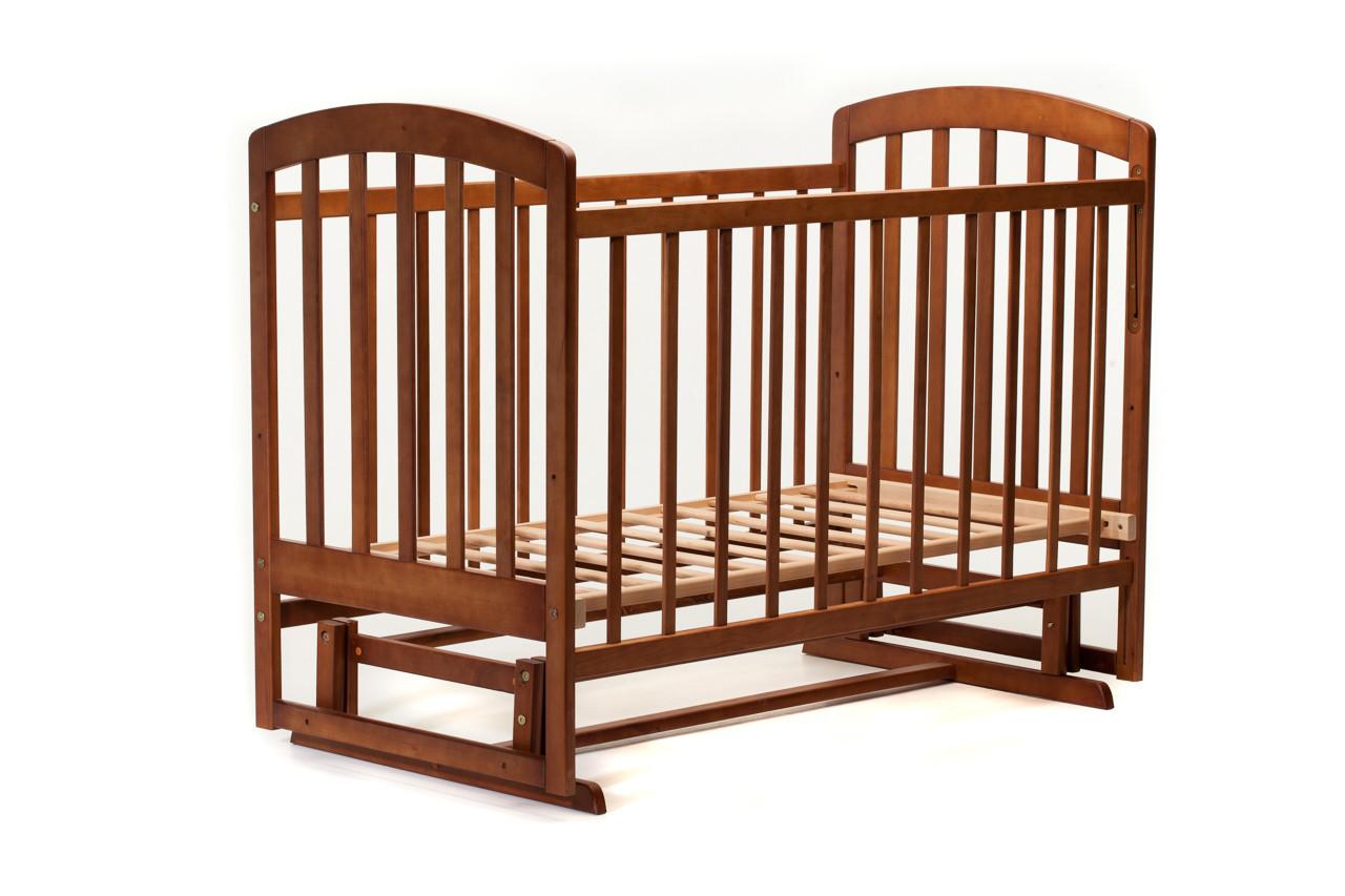 Детская кроватка «LASKA» с маятником ( натуральный лак ) Орех