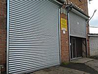 Стальные рулонные ворота с вальным электроприводом из сплошного профиля DoorHan RHS117, фото 1